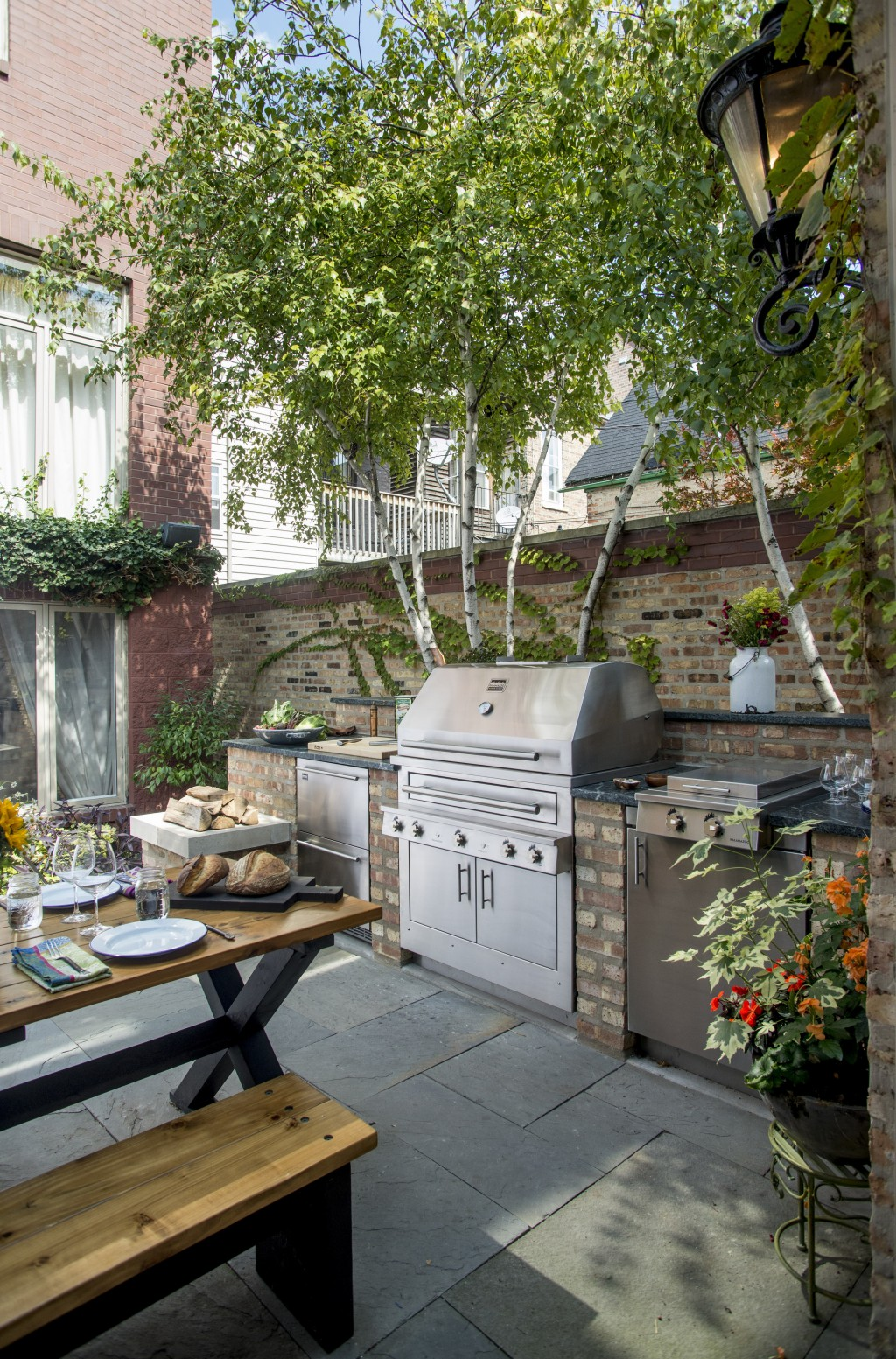 """This photo provided by Kalamazoo Outdoor Gourmet features the company's hybrid fire gas grill, refrigerated drawers and 24"""" double cooktop cabinet in"""