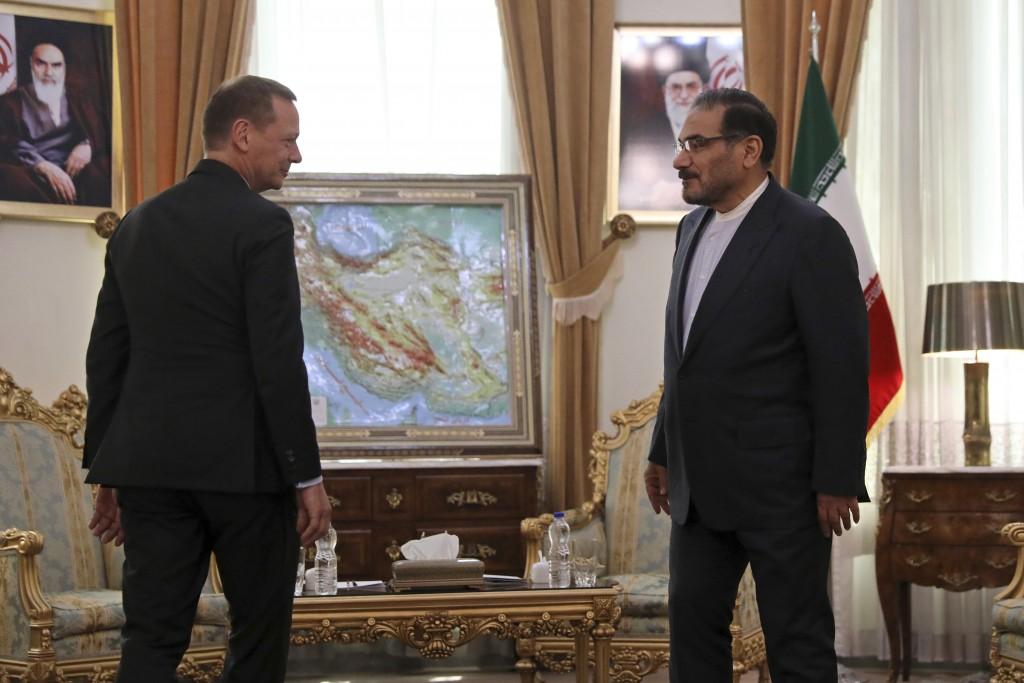 French presidential envoy Emmanuel Bonne, left, is welcomed by Secretary of Iran's Supreme National Security Council Ali Shamkhani for a meeting in Te