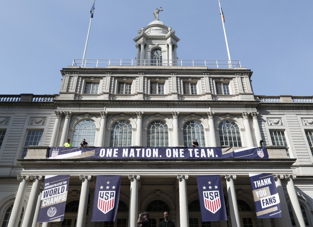 Workers prepare New York's City Hall, decorated with banners in preparation for a ceremony with Mayor Bill de Blasio and other dignitaries scheduled t