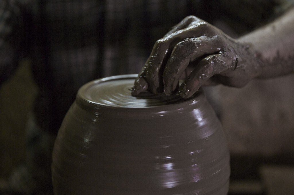 In this Saturday, July 6, 2019 photo, a Palestinian works at a pottery workshop in Gaza City. Talk about old Gaza, and what pops up are images of clay...