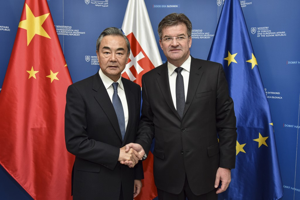 Slovakia Foreign Affairs Minister Miroslav Lajcak, right, poses with his Chinese counterpart Wang Yi for a photo in Bratislava, Wednesday, July 10, 20...