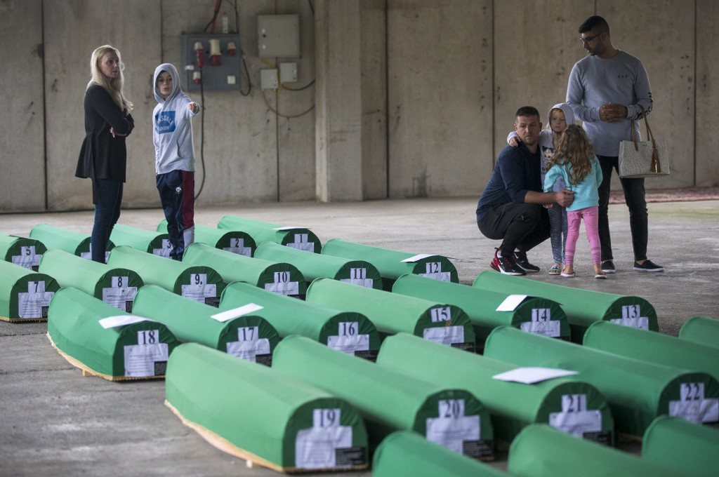 Relatives inspect coffins prepared for burial, in Potocari near Srebrenica, Bosnia, Wednesday, July 10, 2019. The remains of 33 victims of Srebrenica ...