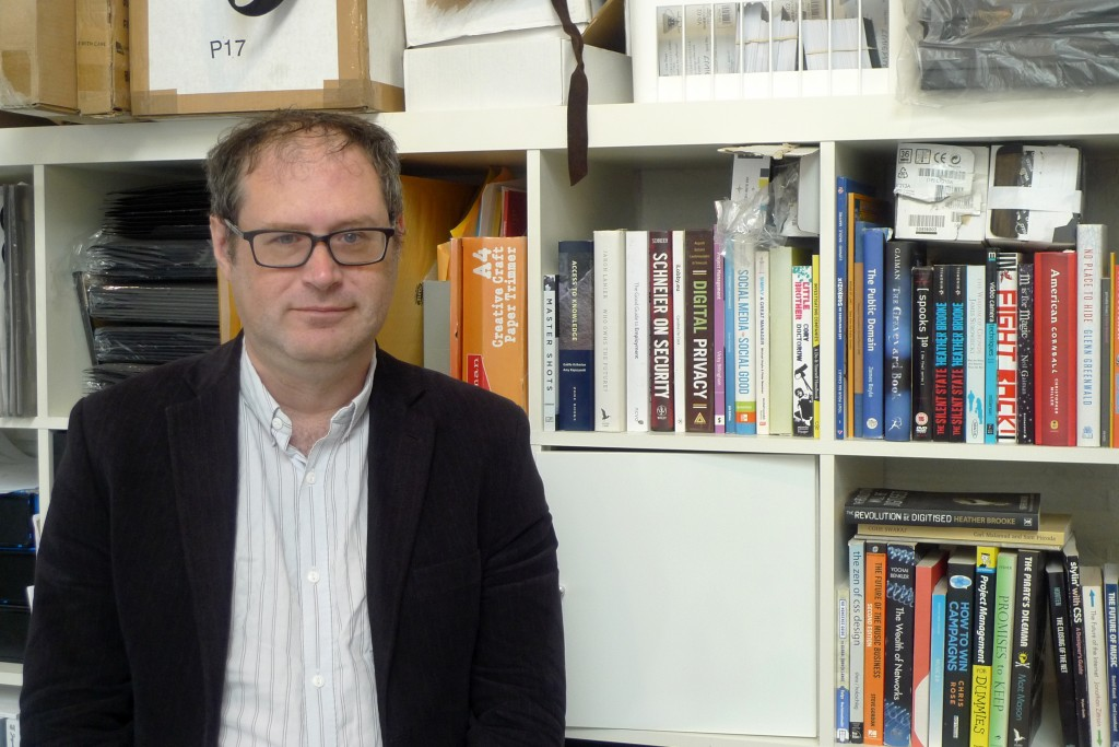 In this June 28, 2019 photo, Jim Killock, executive director of the Open Rights Group, poses for a photo, in the group's London office. The global pus