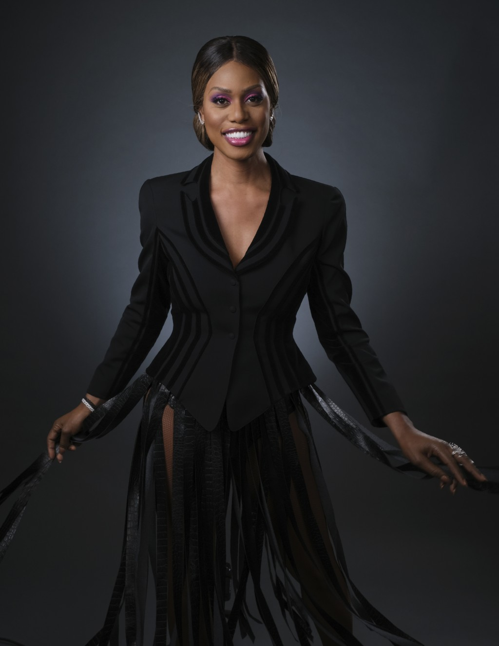 """This June 13, 2019 photo shows actress Laverne Cox posing for a portrait in Los Angeles to promote the 7th season of """"Orange is the New Black."""" The fi"""