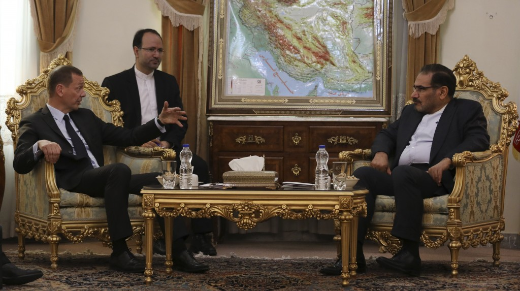 French presidential envoy Emmanuel Bonne, left, talks with Secretary of Iran's Supreme National Security Council Ali Shamkhani during their meeting in...