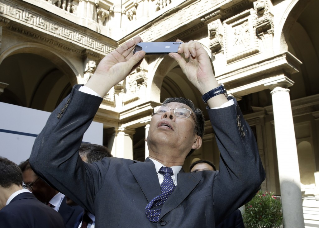 Chinese Minister of Finance Liu Kun, takes pictures on the occasion of the Italy-China Financial forum, at Palazzo Marino town hall, in Milan, Italy, ...
