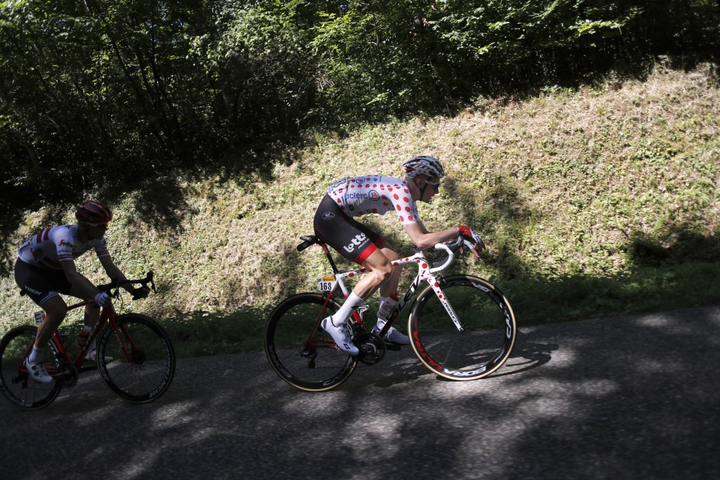 Belgium's Tim Wellens wearing the best climber's dotted jersey, and Latvia's Toms Skujins ride during the fifth stage of the Tour de France cycling ra...
