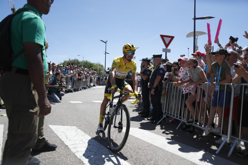 France's Julian Alaphilippe wearing the overall leader's yellow jerse arrives for the start of the fifth stage of the Tour de France cycling race over...