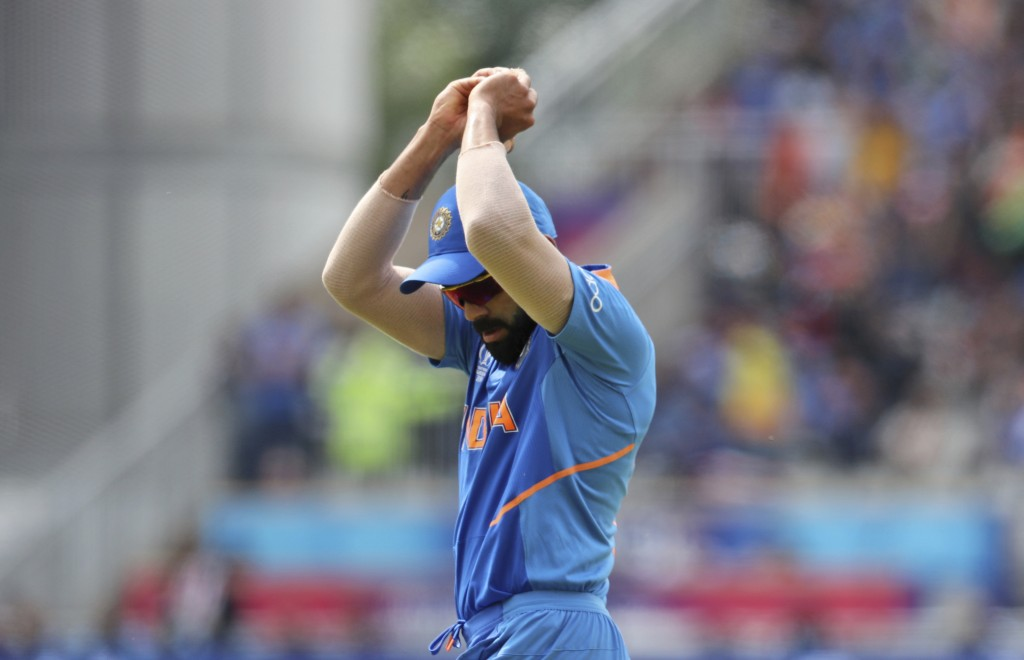 India's captain Virat Kohli takes a catch to dismiss New Zealand's Matt Henry during the Cricket World Cup semifinal match between India and New Zeala
