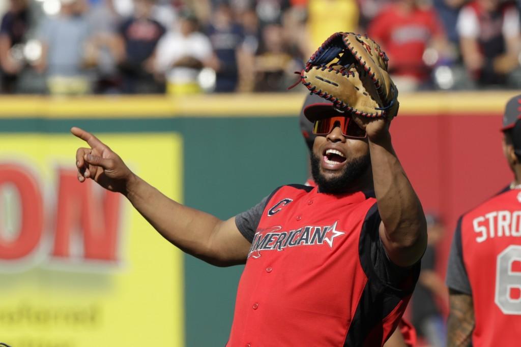 Carlos Santana, of the Cleveland Indians, warm-up ...
