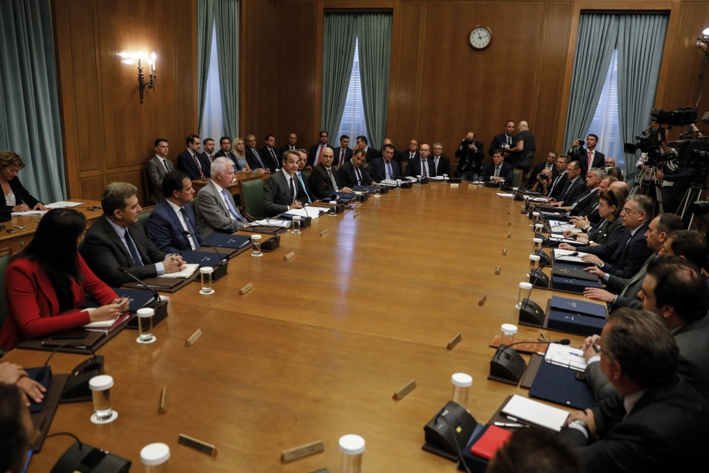Greece's new government participate in the first cabinet meeting in Athens, Wednesday, July 10, 2019. Conservative party leader Kyriakos Mitsotakis wo