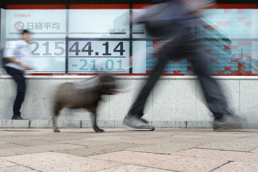 An electronic stock board showing Japan's Nikkei 225 index at a securities firm is seen on a street in Tokyo Wednesday, July 10, 2019. Asian shares we...