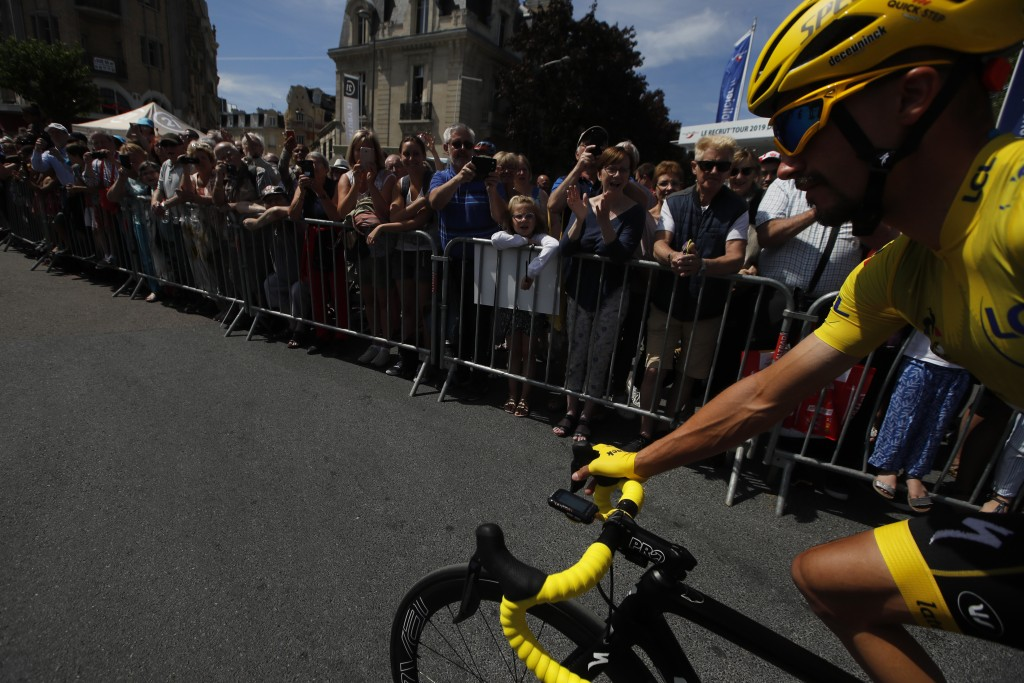 France's Julian Alaphilippe wearing the overall leader's yellow jersey rides prior to the fourth stage of the Tour de France cycling race over 214 kil...