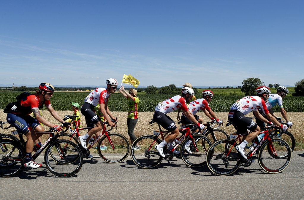 From left riders in the pack Spain's Ivan Garcia Cortina, Belgium's Tiesj Benoot, Belgium's Thomas de Gendt, Australia's Caleb Ewan, and Belgium's Max