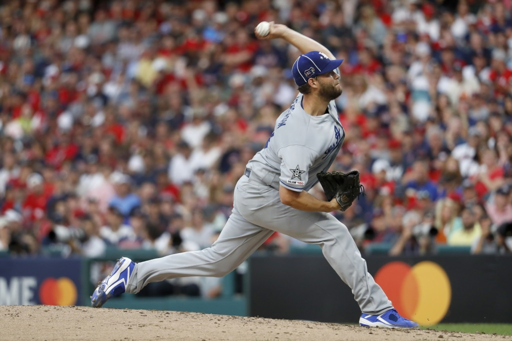 National League pitcher Clayton Kershaw, of the Los Angeles Dodgers, throws during the second inning of the MLB baseball All-Star Game against the Ame