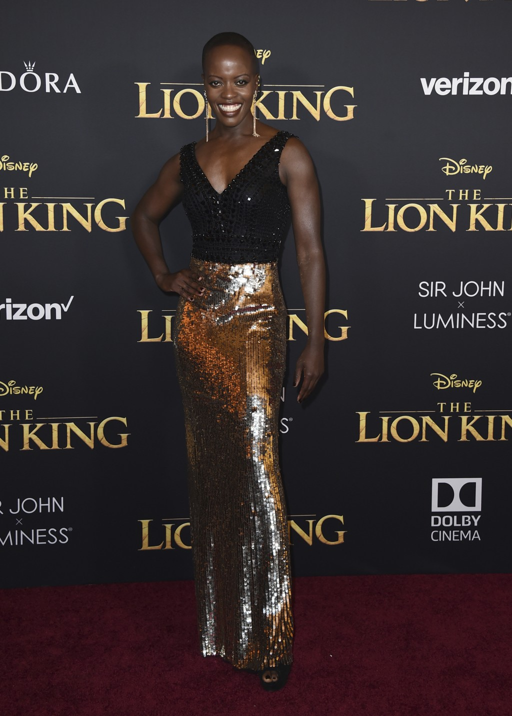 """Florence Kasumba arrives at the world premiere of """"The Lion King"""" on Tuesday, July 9, 2019, at the Dolby Theatre in Los Angeles. (Photo by Jordan Stra"""