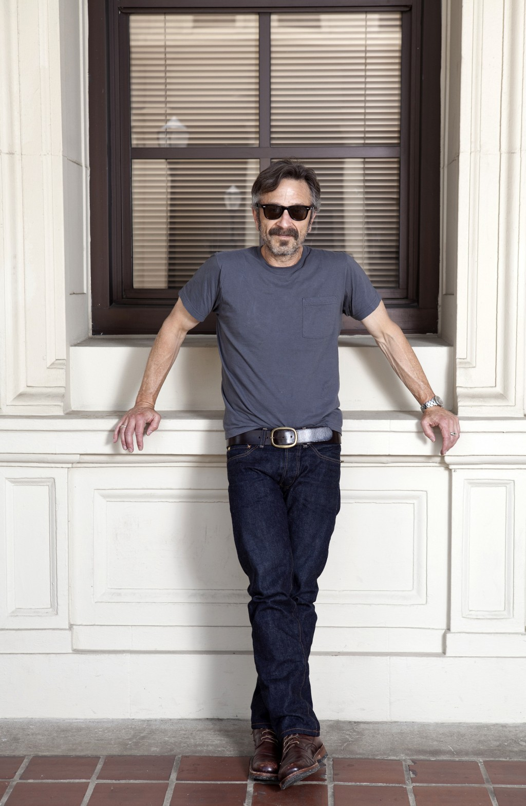 """This June 11, 2019 photo shows actor, comedian and podcaster Marc Maron posing for a portrait in Los Angeles to promote his new indie comedy """"Sword of"""