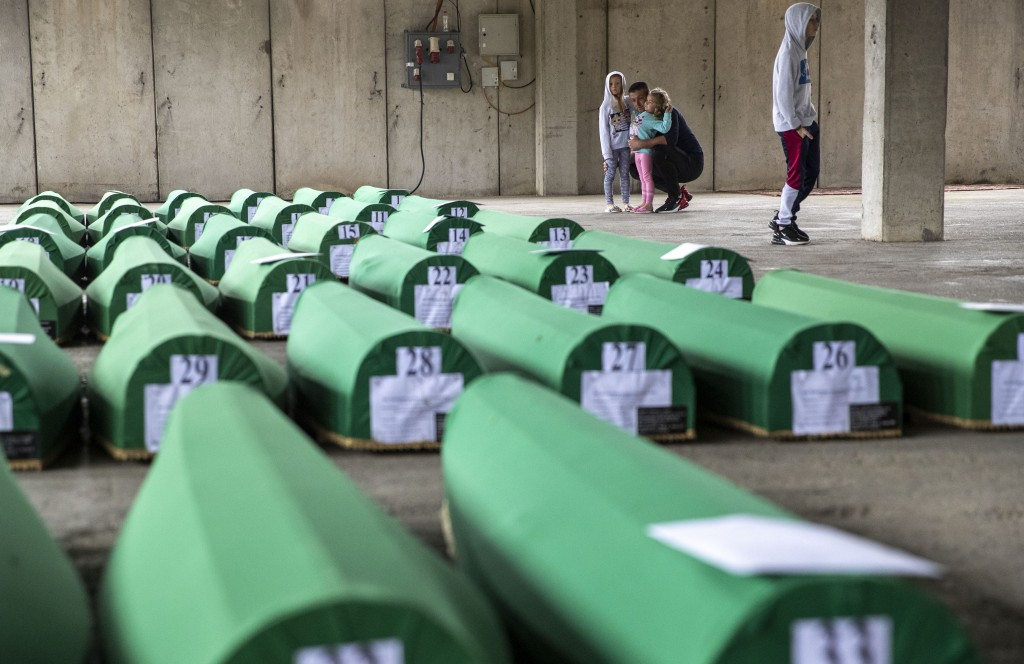 Relatives inspect coffins prepared for burial in Potocari near Srebrenica, Bosnia, Wednesday, July 10, 2019. The remains of 33 victims of Srebrenica m...
