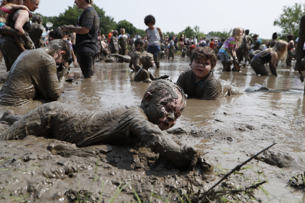 Christian Kubanek, 4 of Lincoln Park plays in the mud during Mud Day at the Nankin Mills Park, Tuesday, July 9, 2019, in Westland, Mich. The annual da...