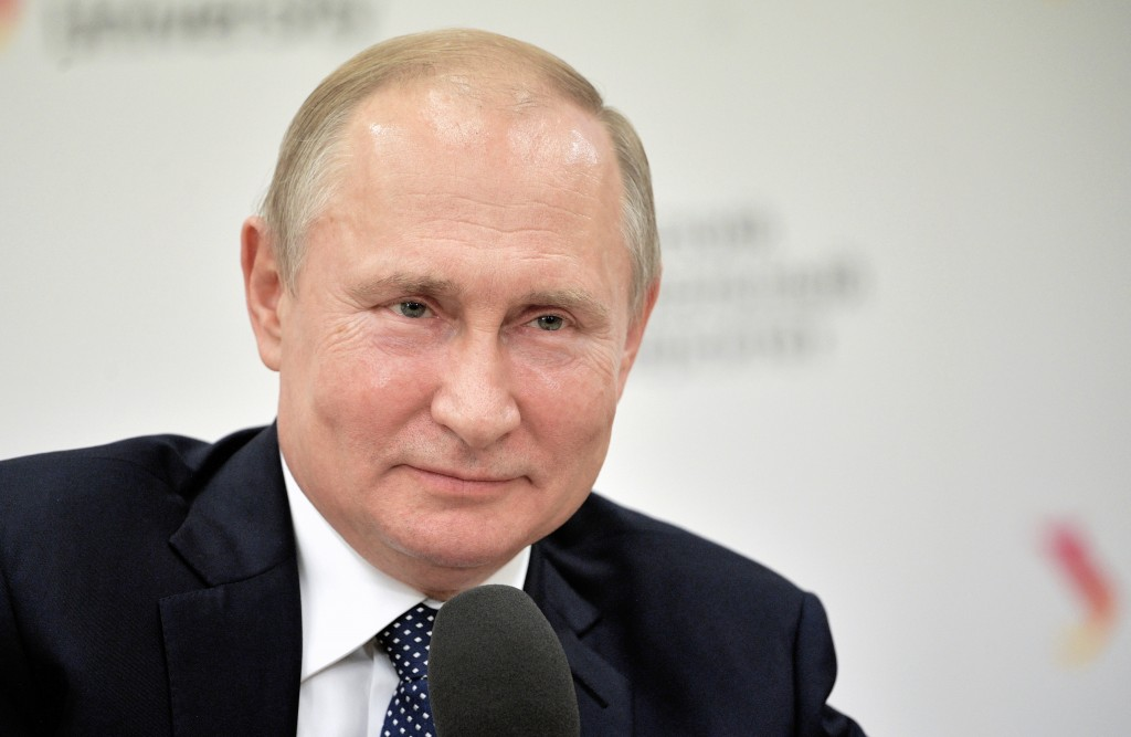 Russian President Vladimir Putin speaks to students on the sidelines of an industrial exhibition in Yekaterinburg, Russia, Tuesday, July 9, 2019. (Ale