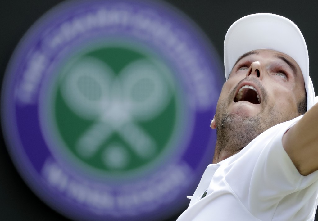 Spain's Roberto Bautista Agut serves to Argentina's Guido Pella during a men's quarterfinal match on day nine of the Wimbledon Tennis Championships in