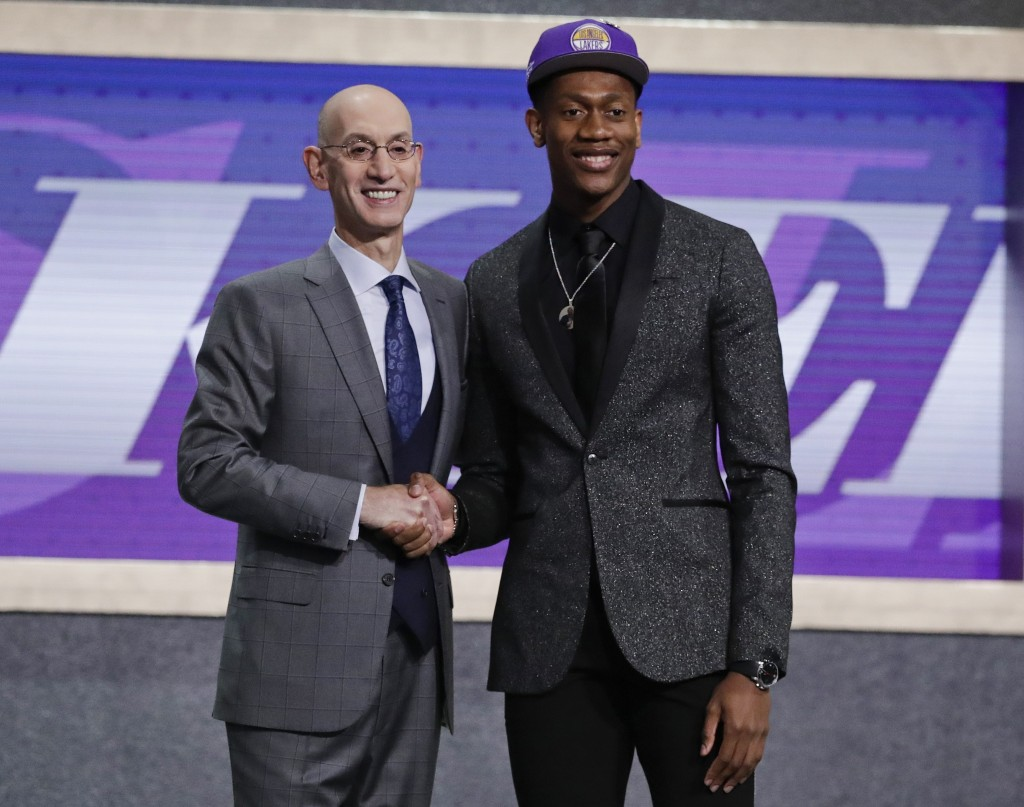 FILE - In this Thursday, June 20, 2019, file photo, Virginia's De'Andre Hunter, right, is greeted by NBA Commissioner Adam Silver after being selected