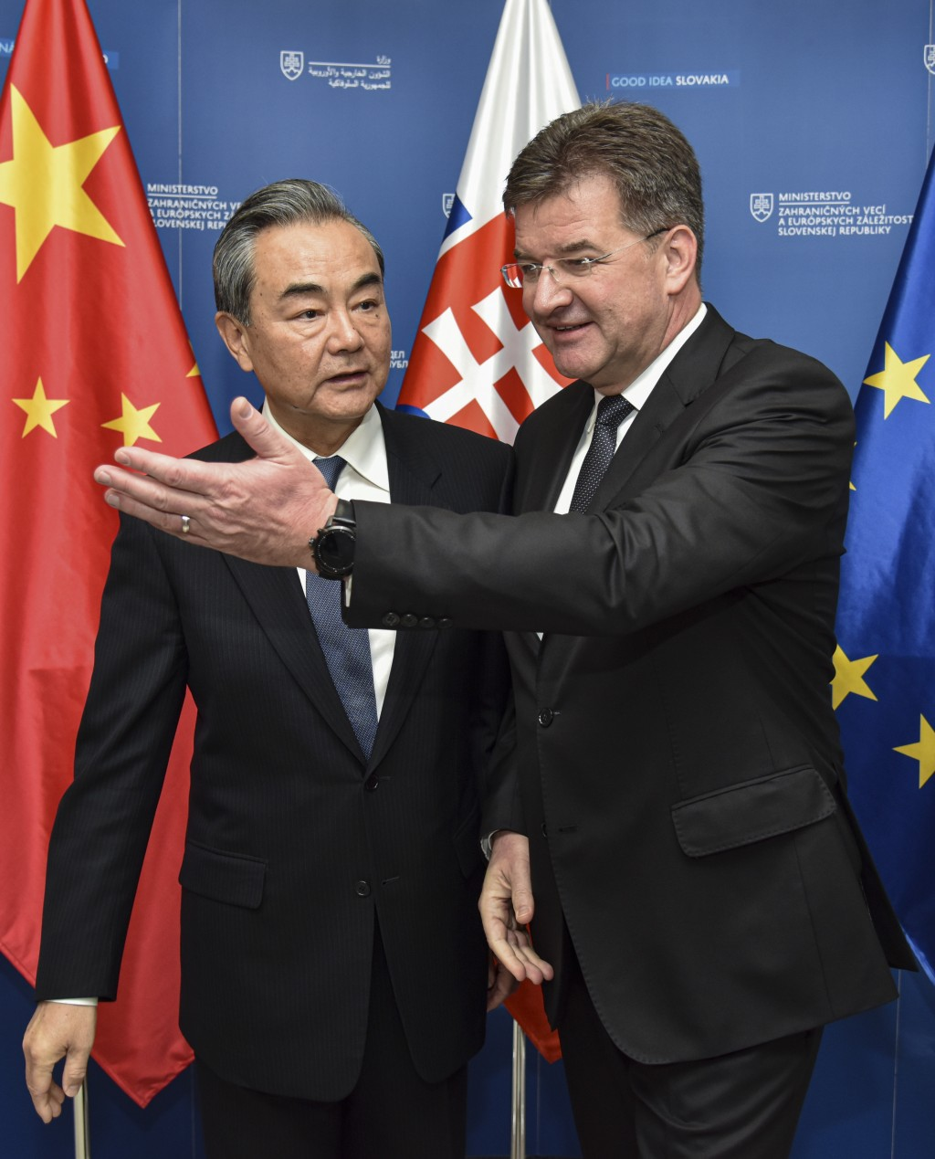 Slovakia Foreign Affairs Minister Miroslav Lajcak, right, poses with his Chinese counterpart Wang Yi for a photo in Bratislava, Wednesday, July 10, 20