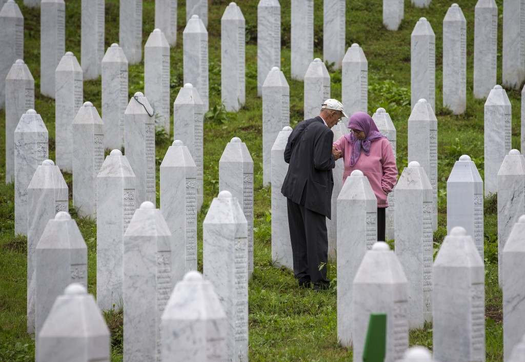 Relatives of victime visit the memorial cemetery in Potocari near Srebrenica, Bosnia, Wednesday, July 10, 2019. The remains of 33 victims of Srebrenic...
