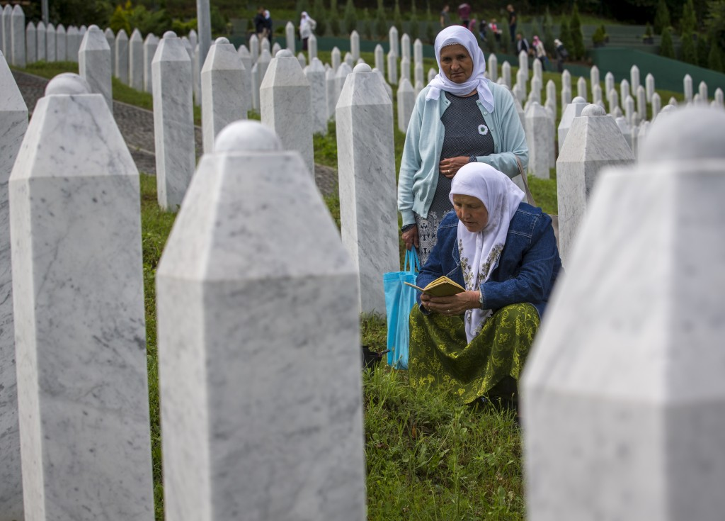 Relatives of victims pray as they visit the memorial cemetery in Potocari near Srebrenica, Bosnia, Wednesday, July 10, 2019. The remains of 33 victims