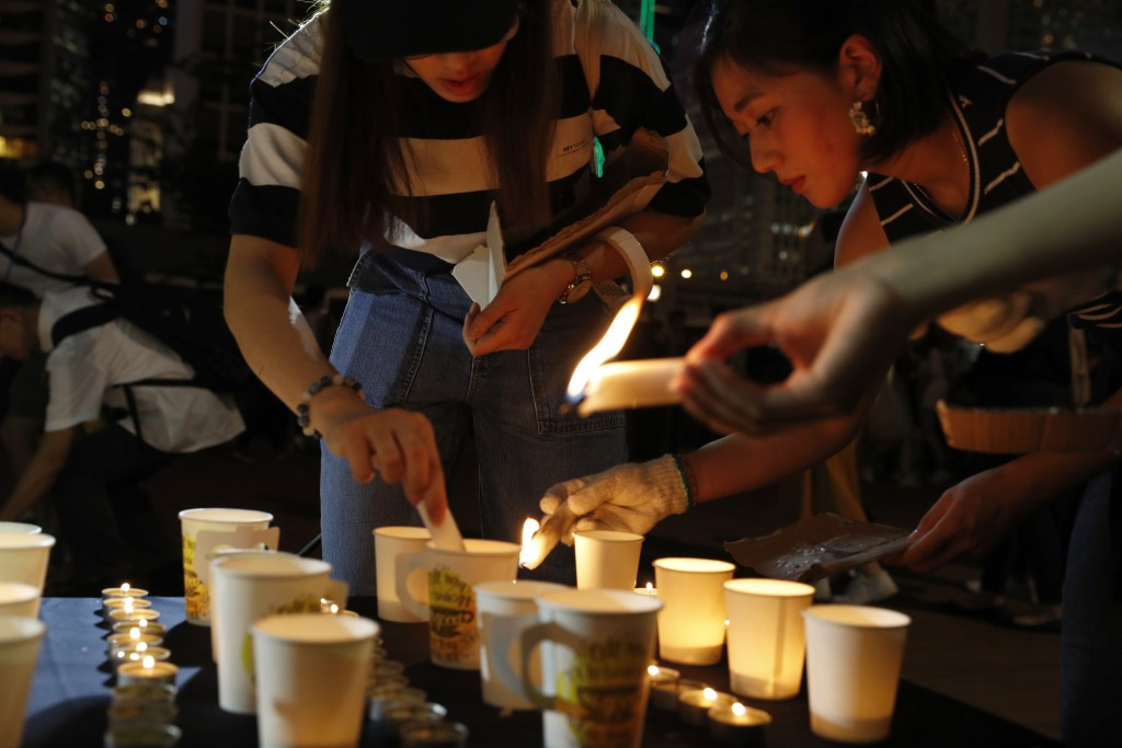 Protesters join a candle light vigil for the fourth apparent suicide related to the protests against an extradition law to China in Hong Kong on Wedne