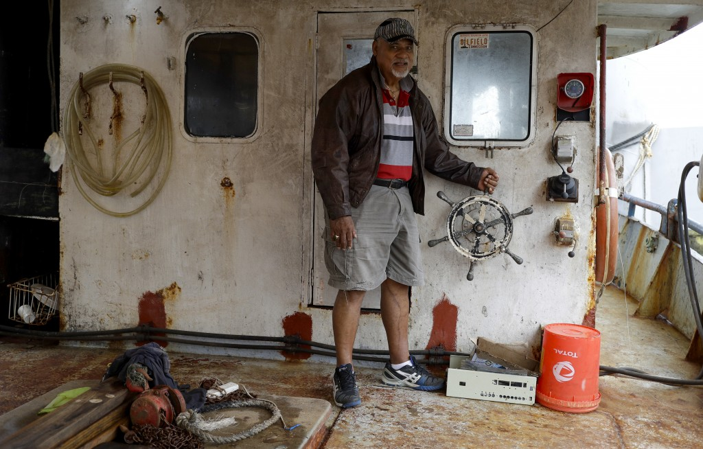 In this Tuesday, April 9, 2019, photo, fisherman a...