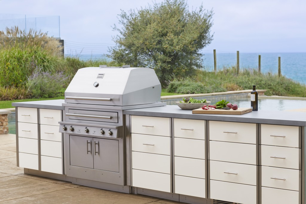 This photo provided by Kalamazoo Outdoor Gourmet of it's Hybrid (charcoal, wood and gas) professional grill and Arcadia series cabinetry is shown at a