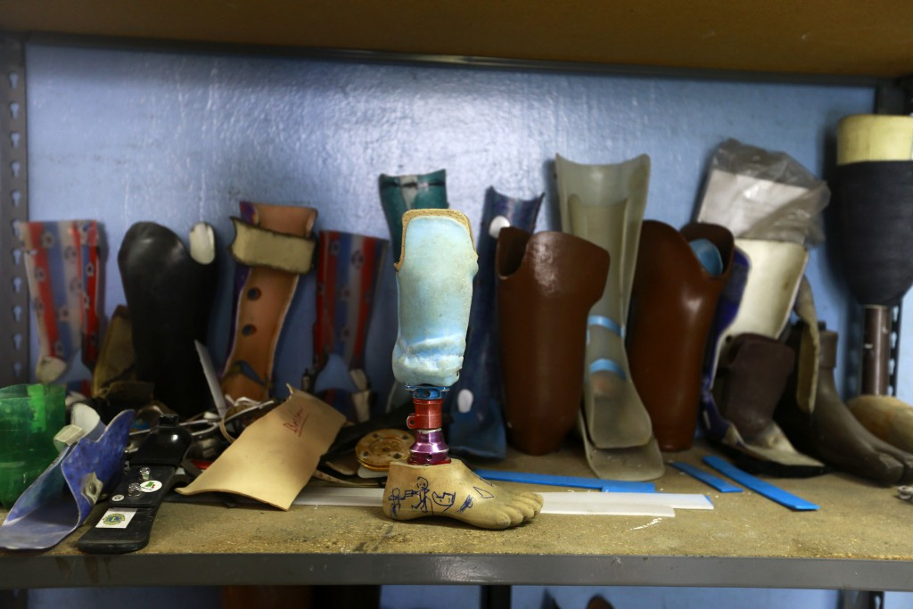 This May 21, 2019 photo shows prosthetics and lower limb orthoses at a workshop in St. Vincent's Center, in Port-au-Prince, Haiti. The technicians at ...