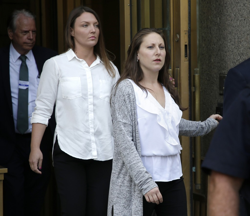 In this Monday, July 8, 2019 photo, Michelle Licata, right, and Courtney Wild, left, leave federal court after wealthy financier Jeffrey Epstein appea