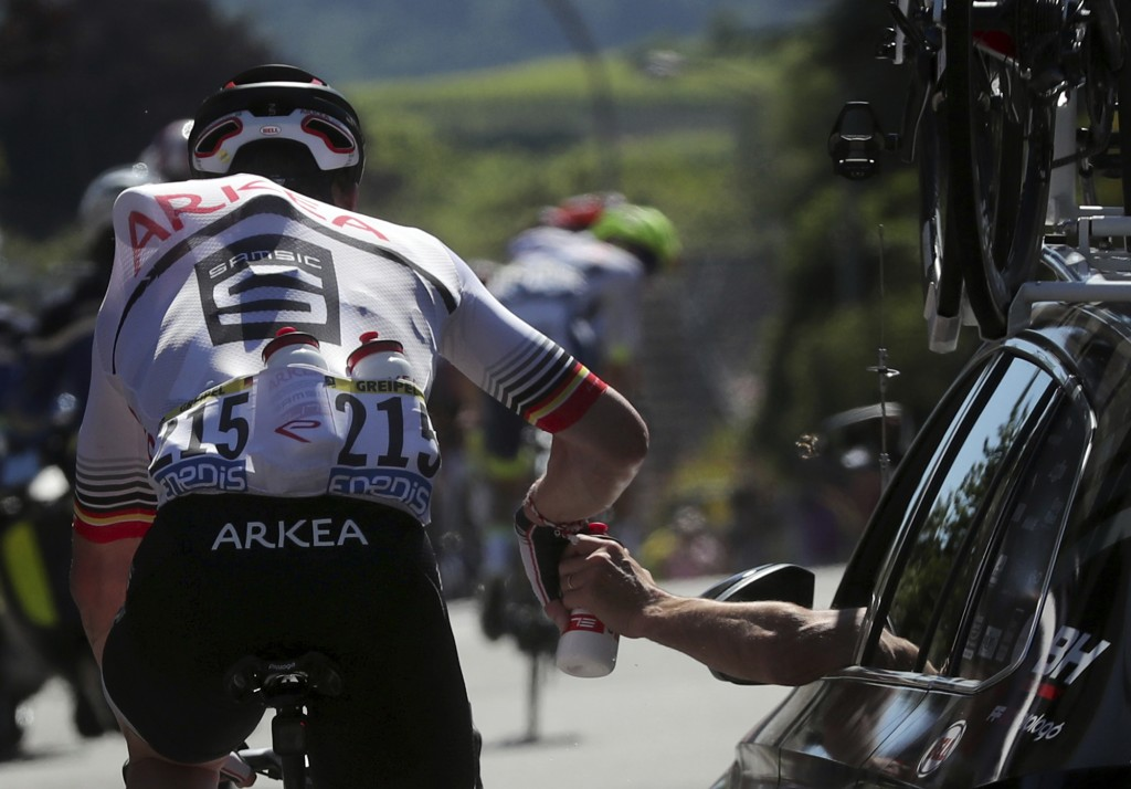 Germany's Andre Greipel takes water from team director car during the fifth stage of the Tour de France cycling race over 175.5 kilometers (109 miles)