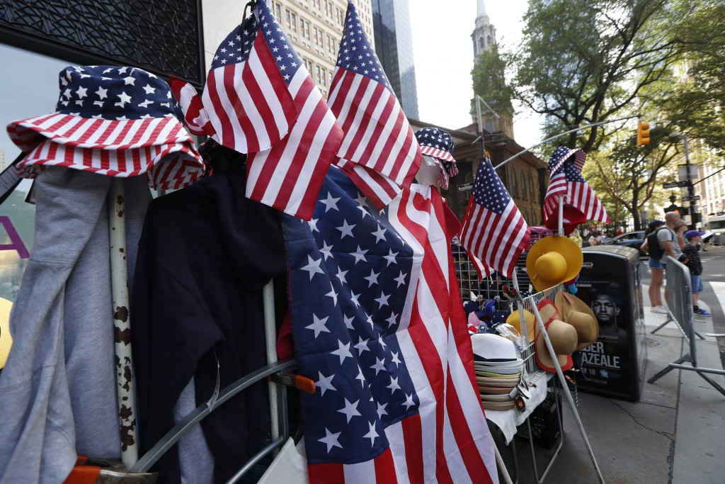 """CORRECTS NICKNAME OF LOWER BROADWAY TO """"CANYON OF HEROES"""", INSTEAD OF CANYON OF CHAMPIONS -  Red, white and blue flag-themed hats and other items are"""
