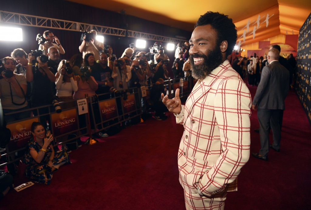 """Donald Glover, a cast member in """"The Lion King,"""" poses at the premiere of the film at the El Capitan Theatre, Tuesday, July 9, 2019, in Los Angeles. ("""