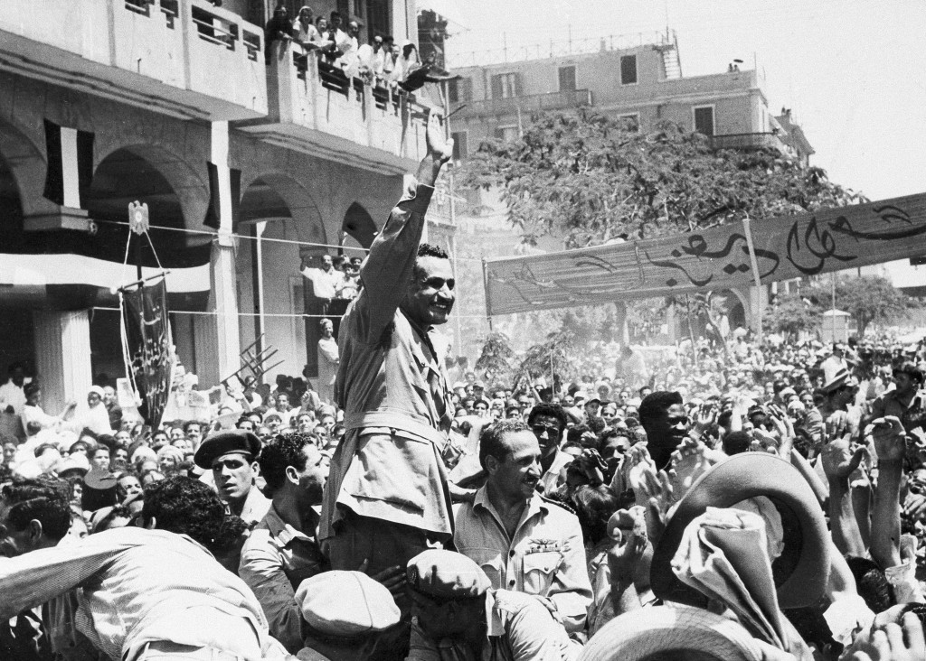 FILE - In this June 18, 1956 file photo, Egyptian leader Gamal Abdel Nasser waves as he moves through Port Said, Egypt, during a ceremony in which Egy