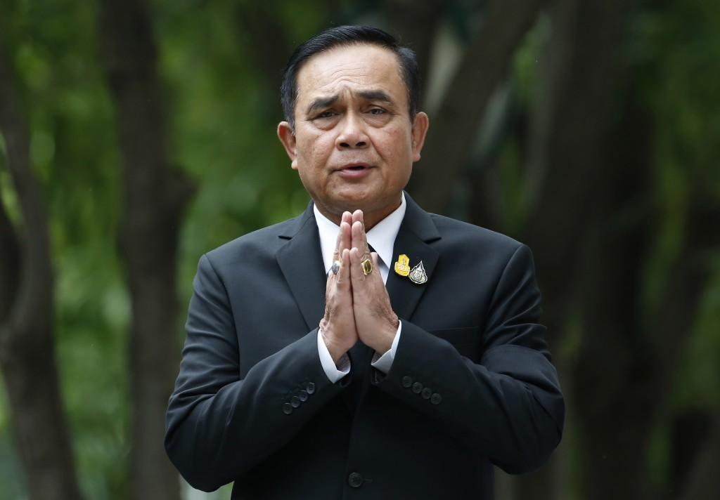 """FILE - In this Thursday, June 6, 2019, file photo, Thailand's Prime Minister Prayuth Chan-ocha gives the traditional greeting, or """"wai,"""" as he talks t"""