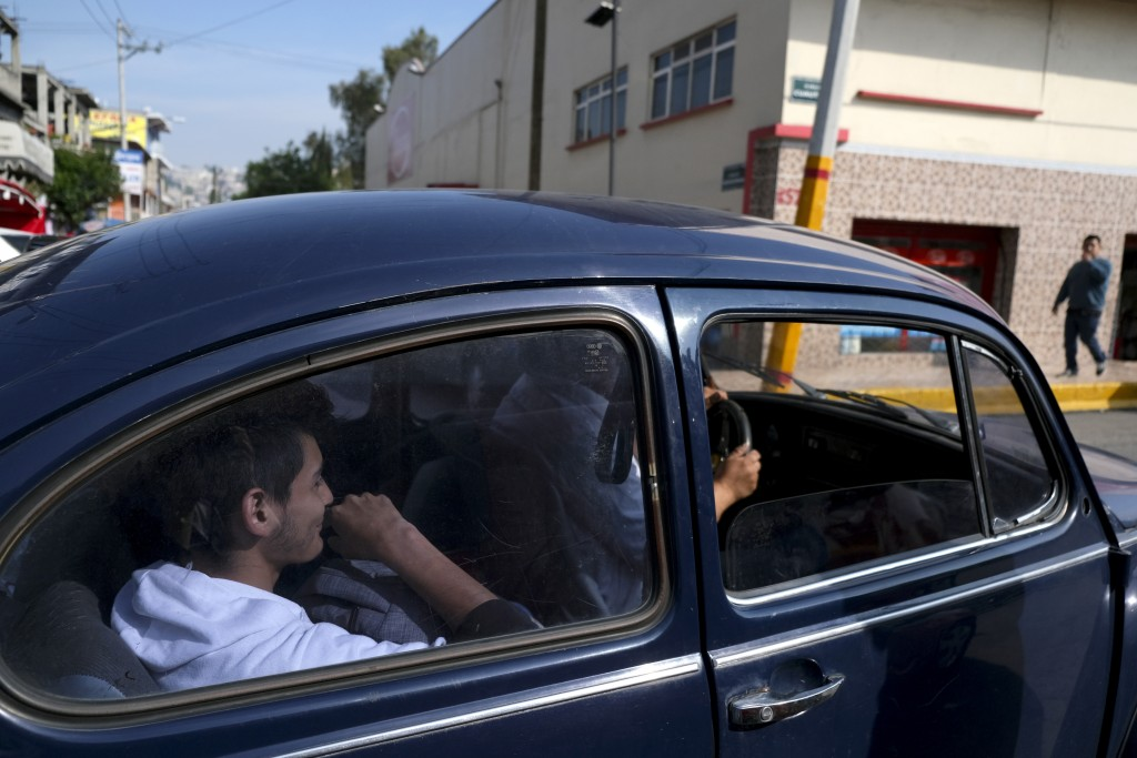 "Passengers catch a taxi in a neighborhood of Mexico City known colloquially as ""Vocholandia,"" for its love of the classic Beetle, called ""vocho"", Tues"