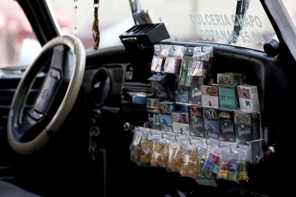 "Candy and cigarettes for sale are stored inside a Volkswagen Beetle in a neighborhood of Mexico City known colloquially as ""Vocholandia,"" for its love"