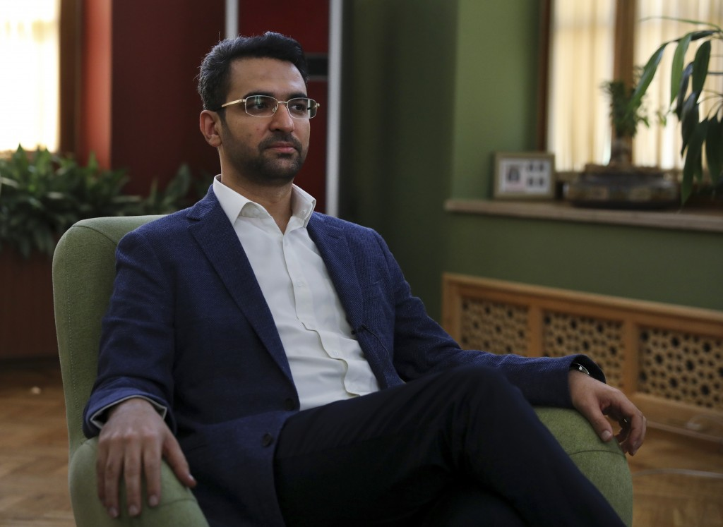 In this Sunday, July 7, 2019 photo, Iran's telecommunications Minister Mohammad Javad Azari Jahromi is interviewed by The Associated Press at his offi...