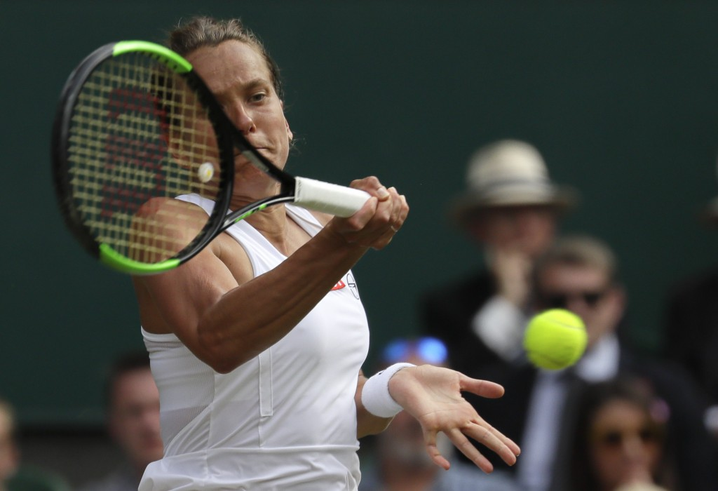 Czech Republic's Barbora Strycova returns the ball to Britain's Johanna Konta during a women's quarterfinal match on day eight of the Wimbledon Tennis...