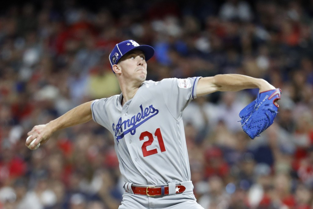 National League pitcher Walker Buehler, of the Los Angeles Dodgers, throws during the fifth inning of the MLB baseball All-Star Game against the Ameri