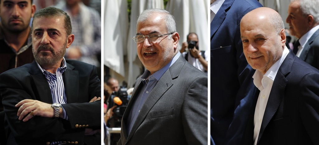 This combination of three photo shows, from left, Wafiq Safa, a top Hezbollah security official, and Lebanon Parliament members Muhammad Hasan Ra'd an...