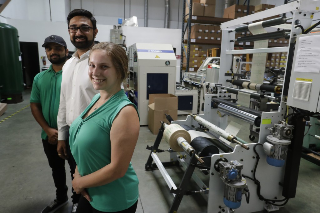 In this Friday, July 5, 2019, photo Achyut Patel, Director of Operations, Rudy Patel, Director of Business Development an Katrina Hart, business devel...