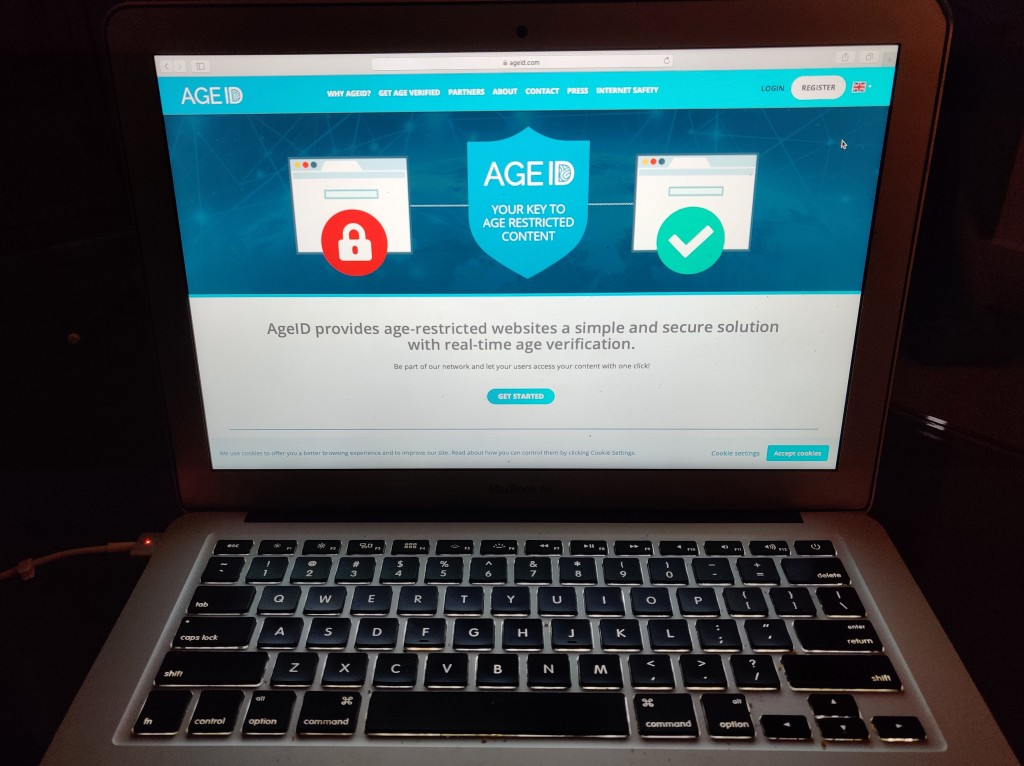 This photo taken in London on Monday July 8, 2019, shows a laptop screen displaying the website for AgeID, an age verification system for the British