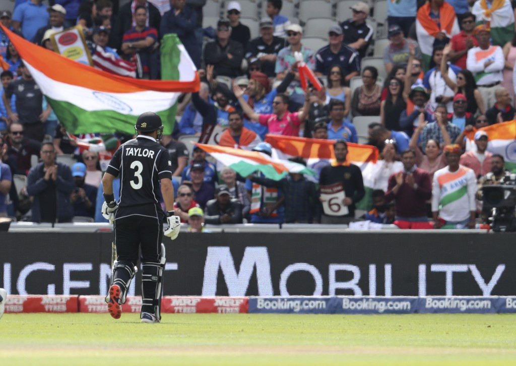 New Zealand's Ross Taylor leaves the field after being dismissed during the Cricket World Cup semifinal match between India and New Zealand at Old Tra