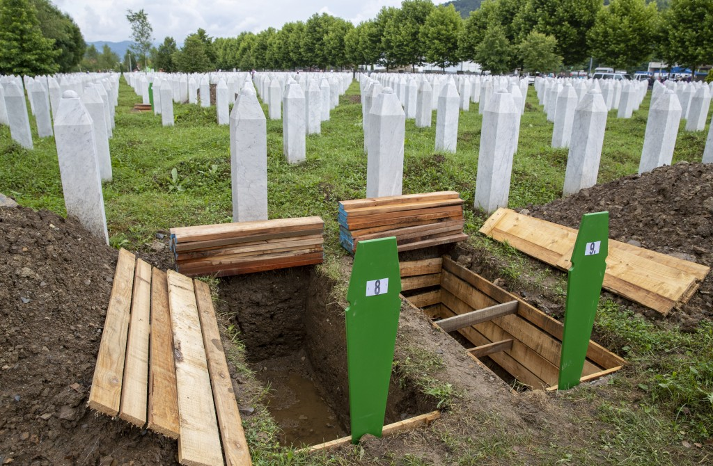 Fresh graves are dug at the memorial cemetery in Potocari near Srebrenica, Bosnia, Wednesday, July 10, 2019. The remains of 33 victims of Srebrenica m...