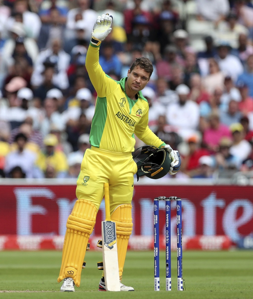 Australia's Alex Carey calls for medical help after he was hit off the bowling of England's Jofra Archer during the Cricket World Cup semi-final match...